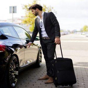 man getting into black car