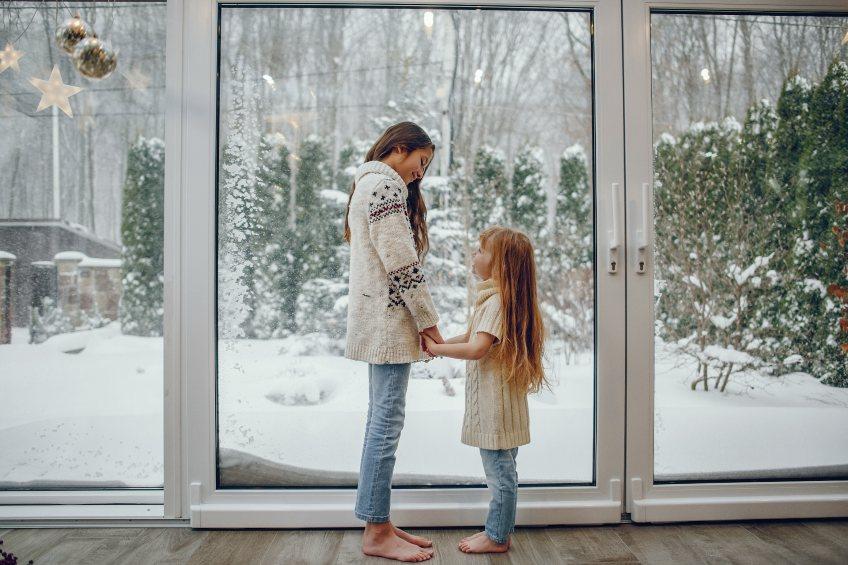 girls in front of snowy window