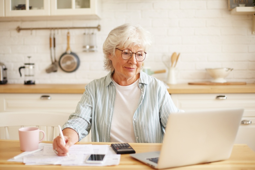 woman looking at her cooling bills