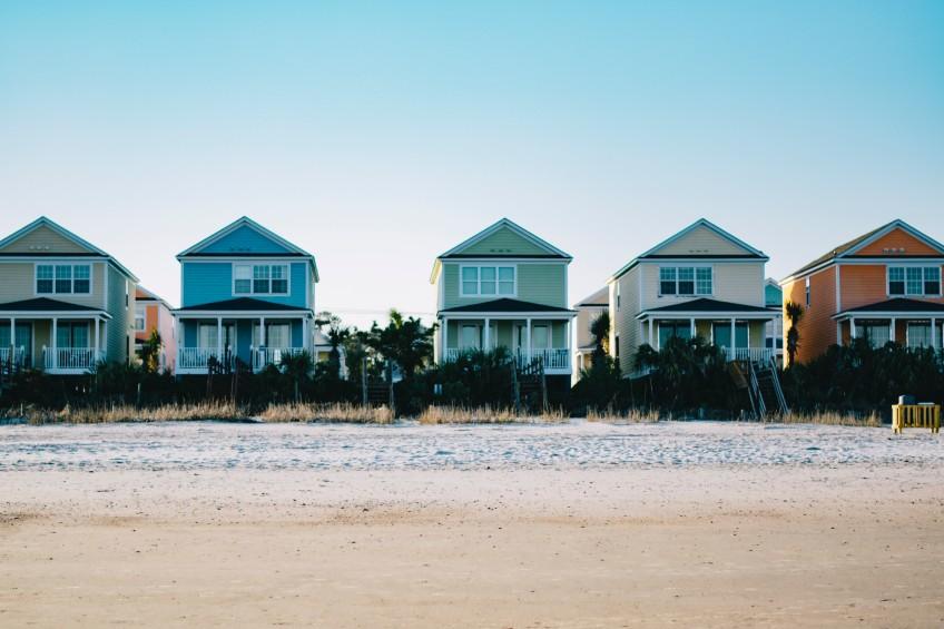 colorful beach houses along the coast