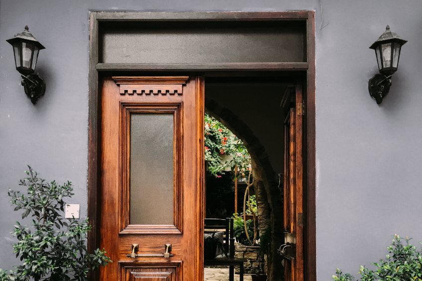 large wooden front doors with frosted vinyl or etched glass windows